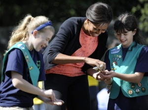 U.S. first lady Michelle Obama plants herb seeds with school children for the fourth annual White House Kitchen Garden spring planting on the South Lawn of the White House in Washington