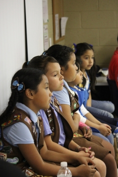 The Brownies listen intently.