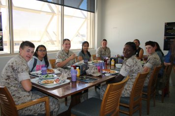 Girls enjoy a power lunch with the marines!